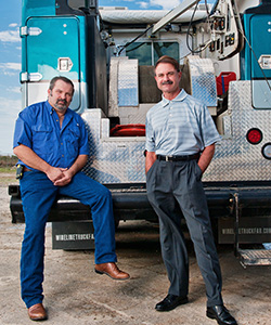 Chris Clark and Guy Stone(jeans) with one of C&S Wireline's service trucks at their business in Corpus Christi.